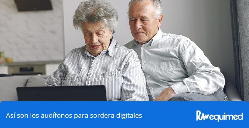 pareja de ancianos con audifonos para sordera digitales